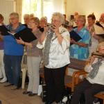 """""""Wir haben Freude zu verschenken""""</br>Grillfest mit Chormusik im """"Herminenhof"""""""