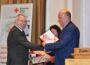Ehrungen für Bernd Koller: </br> Verdienstmedaille des DRK-Landesverbandes und Ehrenmedaille des Feuerwehr-Landesverbandes